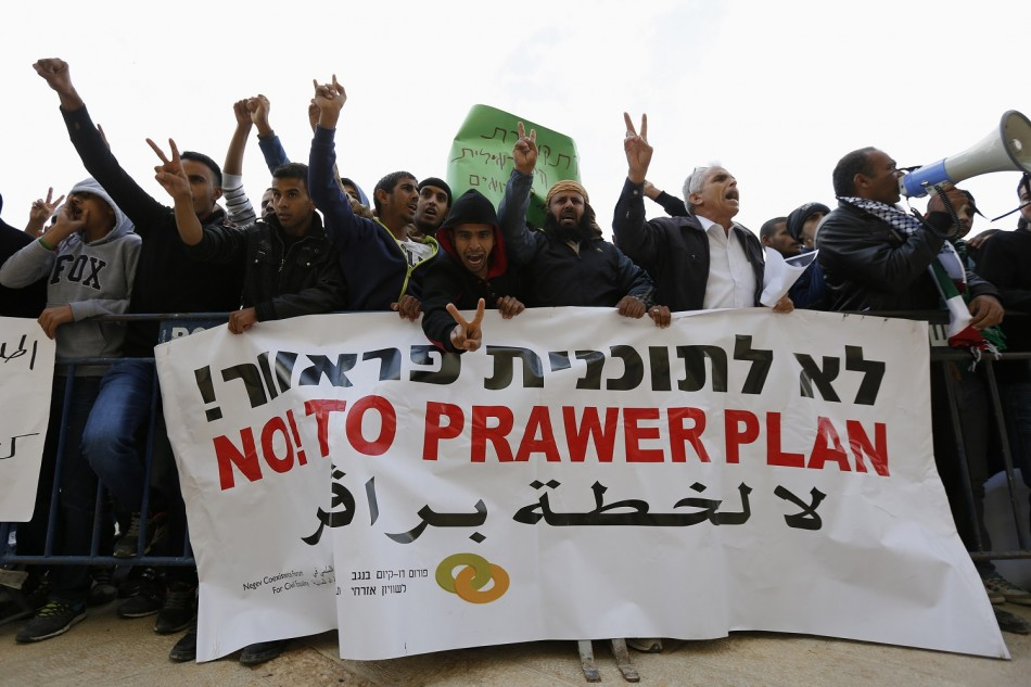 Members of the Bedouin community gesture during a protest outside a court in the southern city of Beersheba