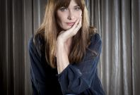"""Carla Bruni-Sarkozy poses for a portrait as she promotes her new album """"Little French Songs"""" in New York, June 25, 2013. (Reuters)"""