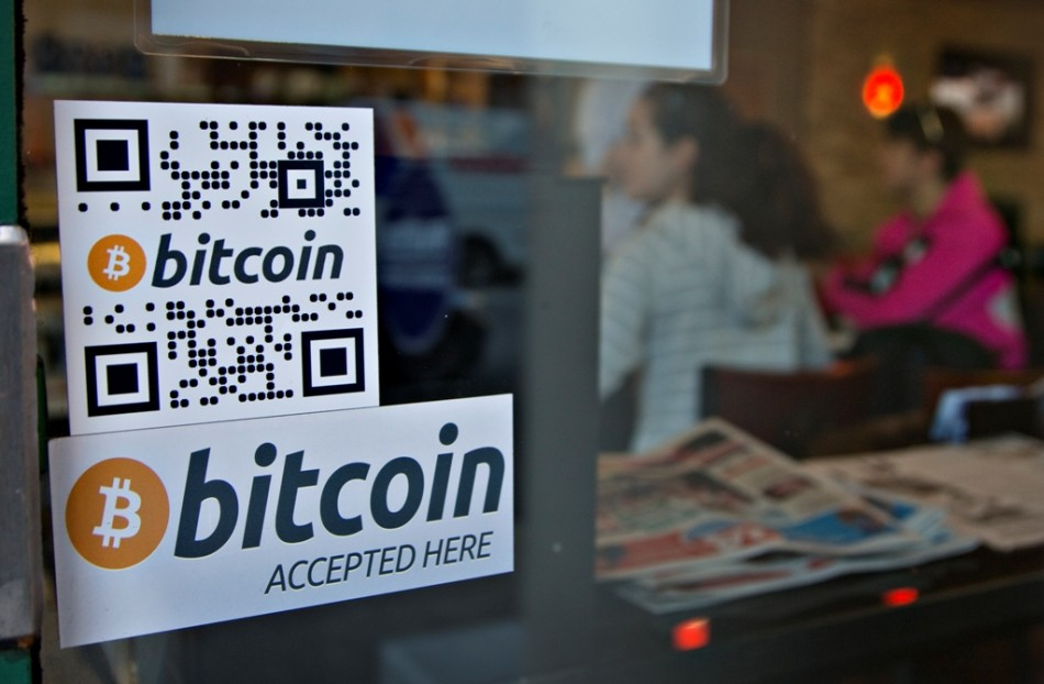 Signs on window advertise a bitcoin ATM machine