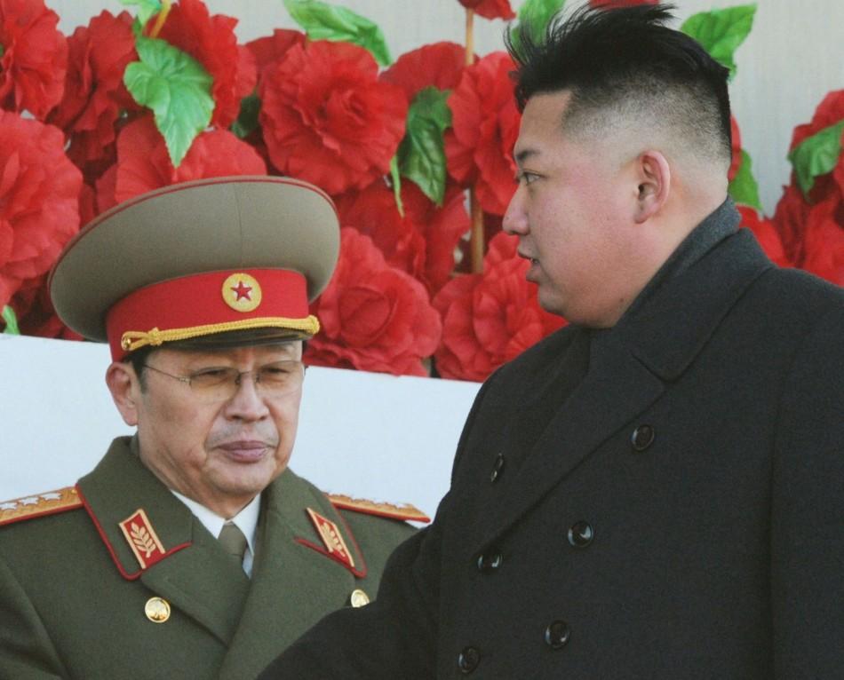 North Korean leader Kim Jong-un and his uncle Jang Song-thaek, whom he has executed, at a military parade to mark the birth anniversary of the North's late leader Kim Jong-il in Pyongyang, in 2012. (Reuters)