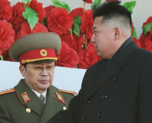 North Korean leader Kim Jong-un and his uncle Jang Song-thaek, whom he has executed, at a military parade to mark the birth anniversary of the North's late leader Kim Jong-il in Pyongyang, in 2012. (Reuters)