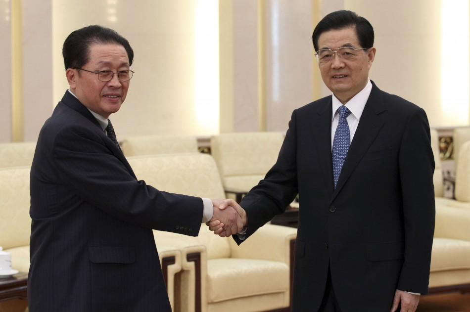 China's President Hu Jintao (R) shakes hands with Jang song-thaek, in Beijing, August 17, 2012. Thaek supported Chinese-style economic reforms and was an important link between Pyongyang and Beijing. (Reuters)
