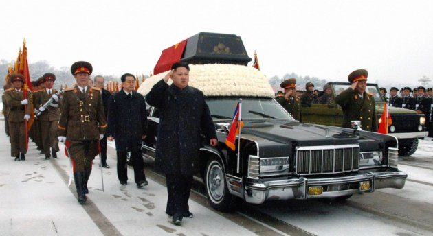 Kim Jong-un and Jang Song-thaek accompany the hearse carrying the coffin of late North Korean leader Kim Jong-il during his funeral procession in Pyongyang. (Reuters)