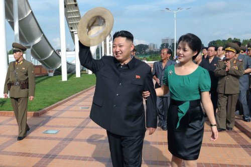 North Korean leader Kim Jong-Un and his wife Ri Sol-ju during a ceremony