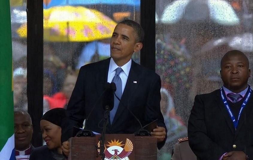 Criminal record? Thamsanqa Jantjie stands near President Barack Obama in Soweto