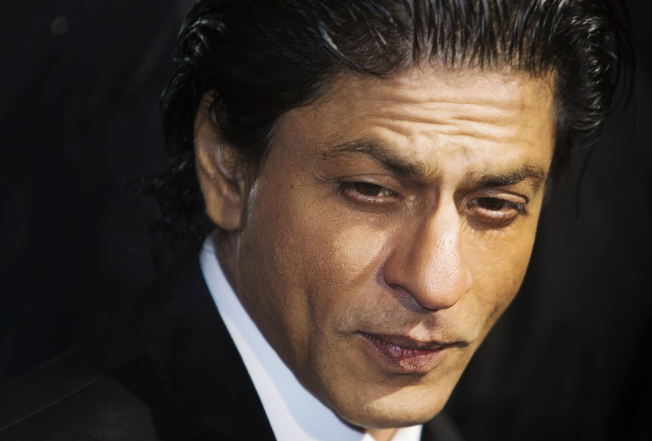 Shah Rukh Khan arrives on the red carpet for the premiere of