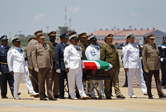 The coffin of former South African President Nelson Mandela is escorted aboard a military cargo plane. (Reuters picture)