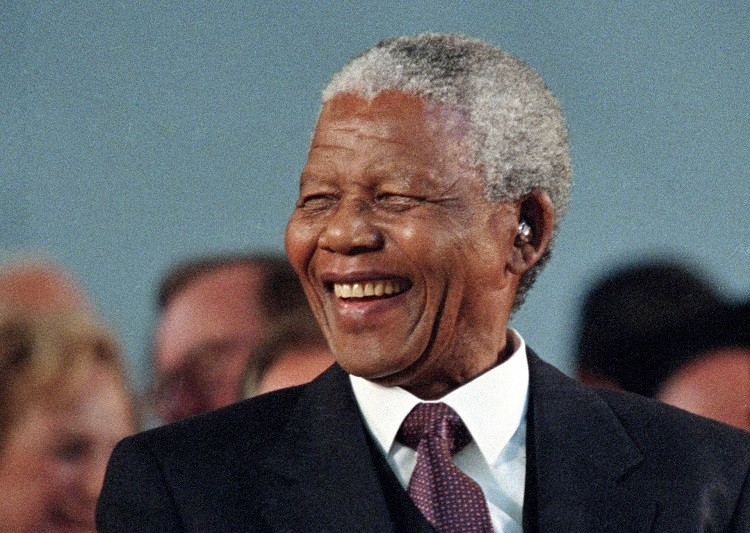 Then South African President Nelson Mandela smiles during a specially convened Harvard University ceremony honoring him in this September 18, 1998. (Reuters picture)