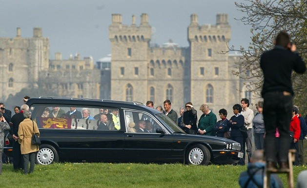Crowds pay their respect at the Queen Mother's coffin passes
