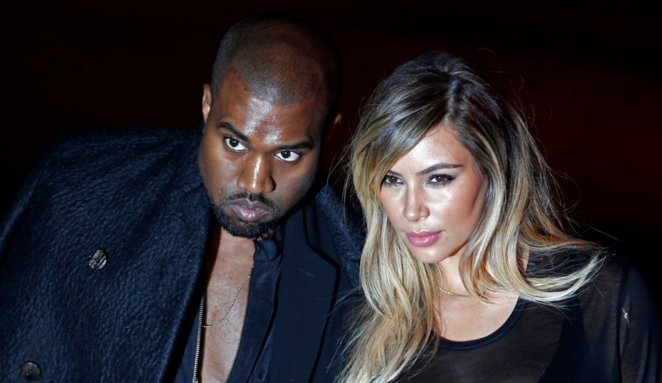 Kanye West Attacks Paparazzi After Being Called a N****r