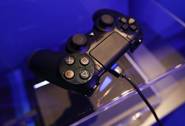 Sony Dualshock 4 controller at an exhibition during Gamescom 2013.