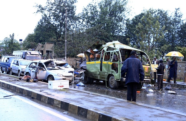 Damaged vehicles are seen at the scene of a blast near Pangani Police Station in Kenya's capital Nairobi, December 14, 2013.