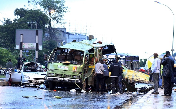 Damaged vehicles are seen at the scene of a blast near Pangani Police Station in Kenya's capital Nairobi, December 14, 2013