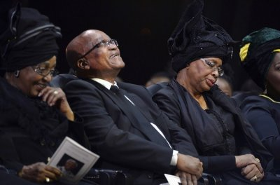 South Africas President Jacob Zuma C, Winnie Mandela L, ex-wife of former South African President Nelson Mandela, and Graca Machel R, widow of Mandela, attend Nelson Mandelas funeral ceremony in Qunu December 15. Reuters picture