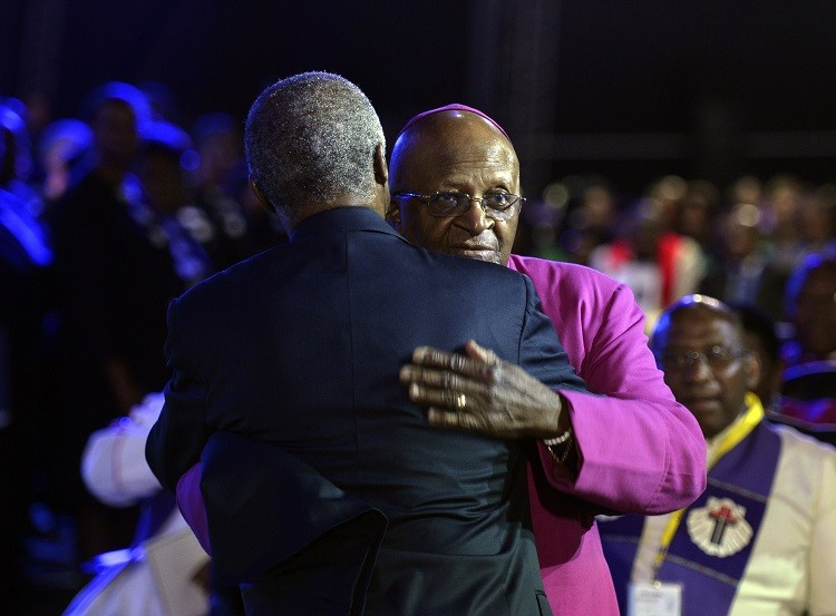 Archbishop Desmond Tutu R and former South African President Thabo Mbeki greet each other before the funeral ceremony of former South African President Nelson Mandela in Qunu December 15, 2013. Reuters picture