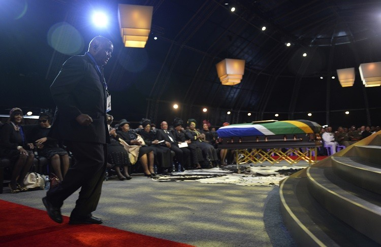 Former President of Zambia Kenneth Kaunda walks to the stage to speak during the funeral ceremony for former South African President Nelson Mandela in Qunu December 15, 2013. Reuters picture