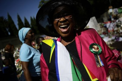 Women dance and sing during a homage outside the Houghton home of the late former South African President Nelson Mandela in Johannesburg December 15, 2013. Reuters picture