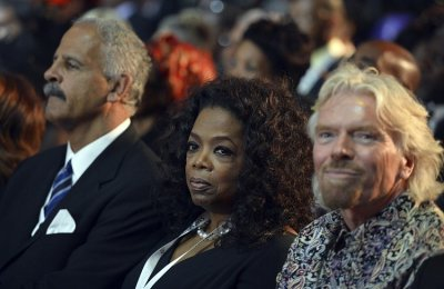 British entrepreneur Richard Branson R and U.S. TV host Oprah Winfrey C attend the funeral ceremony for former South African President Nelson Mandela in Qunu December 15, 2013. Reuters picture