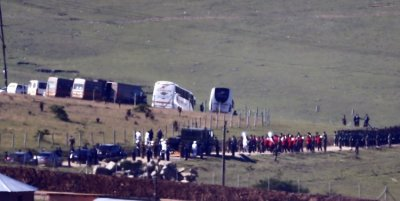 The funeral cortege, carrying the coffin of former South African President Nelson Mandela on a gun carriage, makes its way from his house to a tent where the funeral service will be within the Mandela familys property in the village of Qunu December 15,