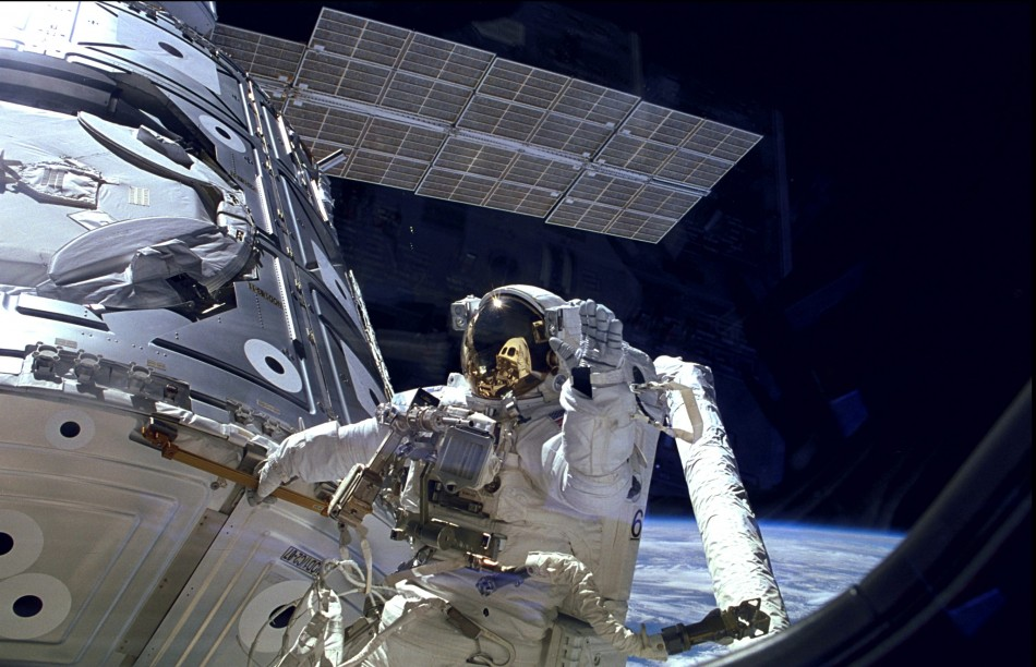 Astronaut James H. Newman waves during a spacewalk preparing for the release of the first combined elements of the International Space Station on November 20, 1998 in this image released on November 20, 2013.