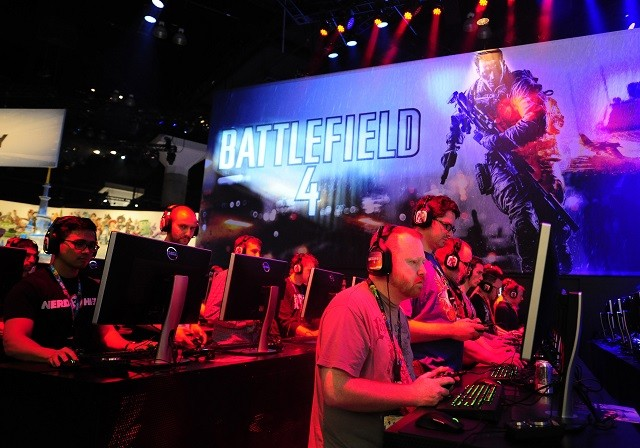 Gamers playing Battlefield 4 during E3 in Los Angeles, 2013