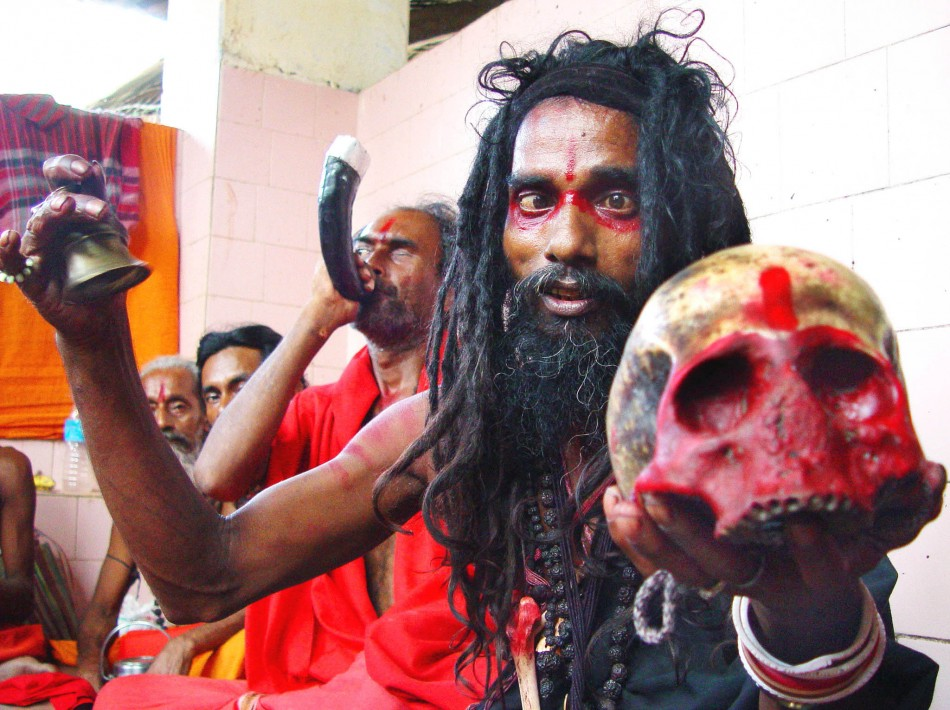 A Black Magic holyman holds a human skull at Guwahati's Kamakhya Temple, which is believed to be the highest seat of Tantra or black magic. A tantrik has been arrested for killing a woman in a human sacrifice in Mumbai. (Reuters)