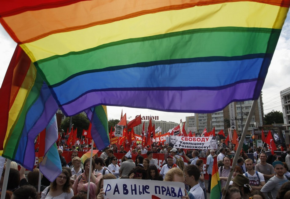 Gay rights activists take part in an opposition protest march in Moscow