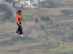 American Slack Liner walks across Canyon In China