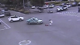 Amazing escape as child falls from moving car in China