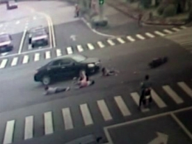 Car Crashes into 5 people on Motorbike in China