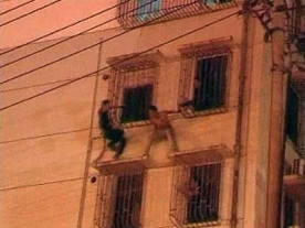 Abseiling Chinese cop swoops to thwart suicide attempt