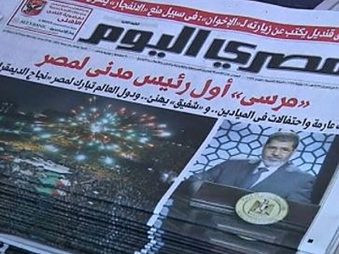 Egypt's president-elect Mursi begins forming government