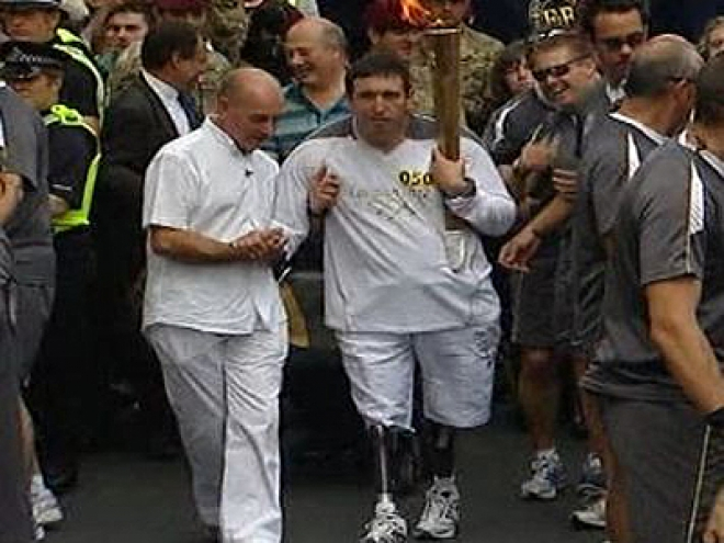 Soldier injured in Afghanistan carries Olympic Torch