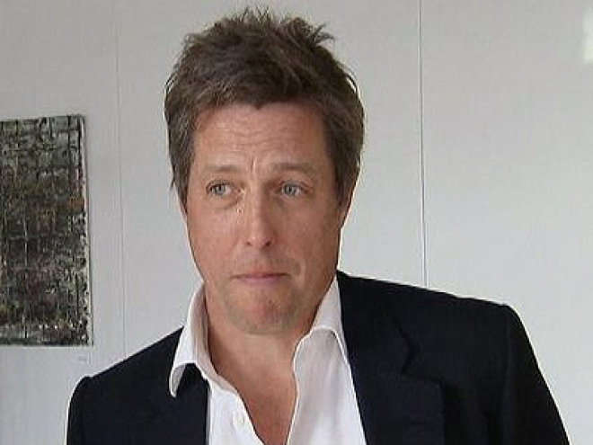 Hugh Grant calls for EU-wide media regulation
