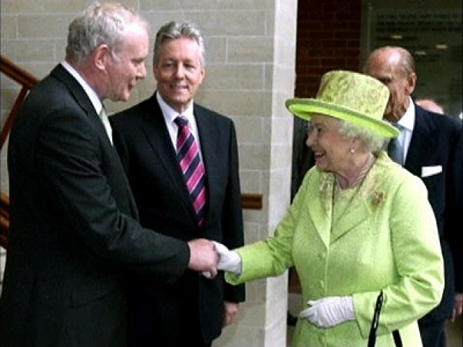 The Queen shakes hands with former IRA Commander