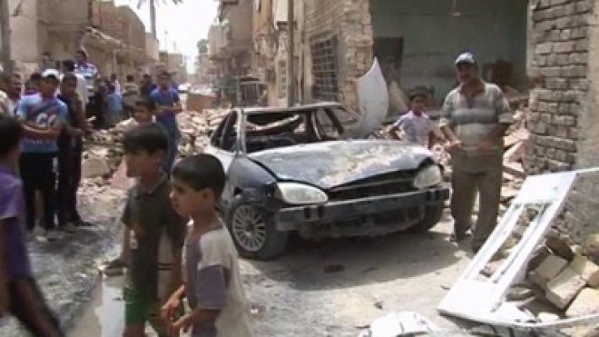 Three bomb blasts in Iraq kill at least 14 people