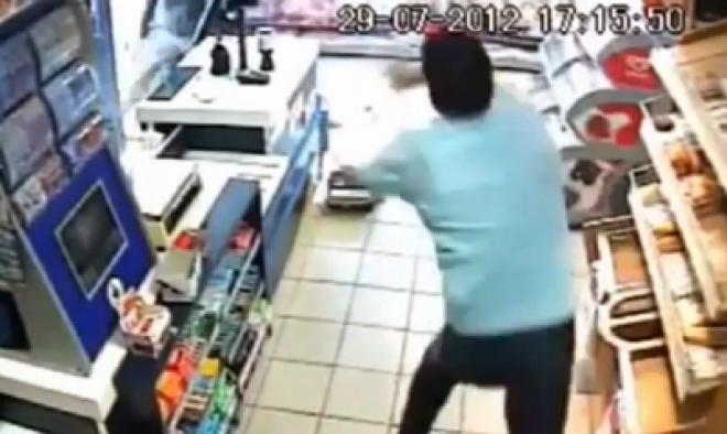 Brave shop worker fends off armed robber