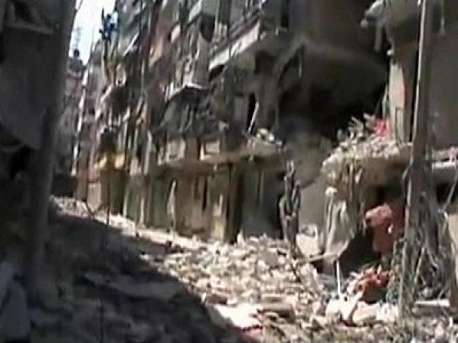 Syrian pro-Assad forces reclaim Aleppo district
