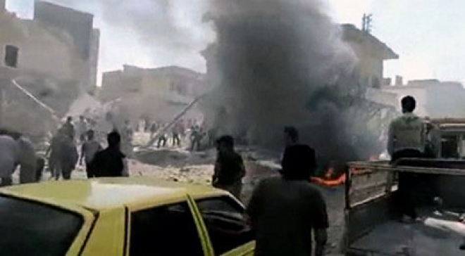 Deadly car bomb hits funeral in Damascus suburb