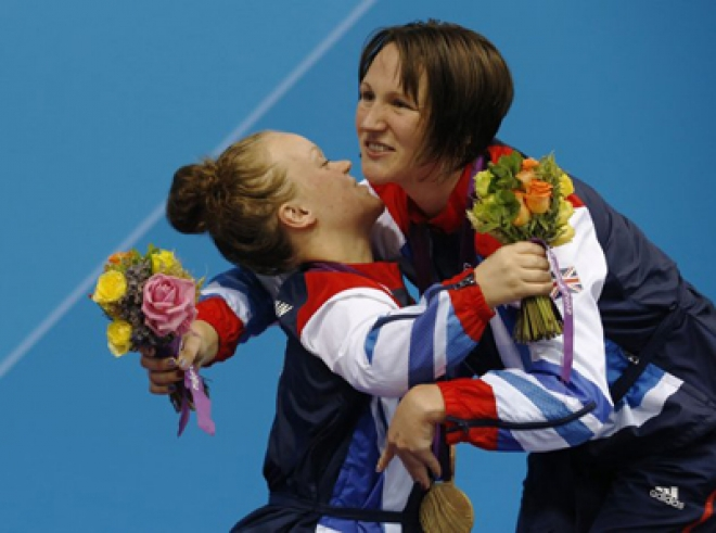 Britain cement second place with triple gold