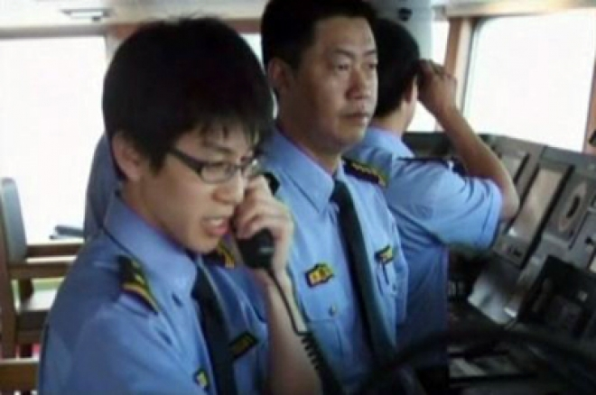 China ships sail in waters near disputed islands