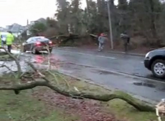 Three dead: floods and gales batter Britain