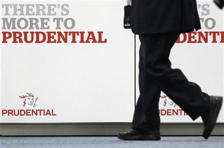 Shareholder arrives at Prudential's annual general meeting in central London