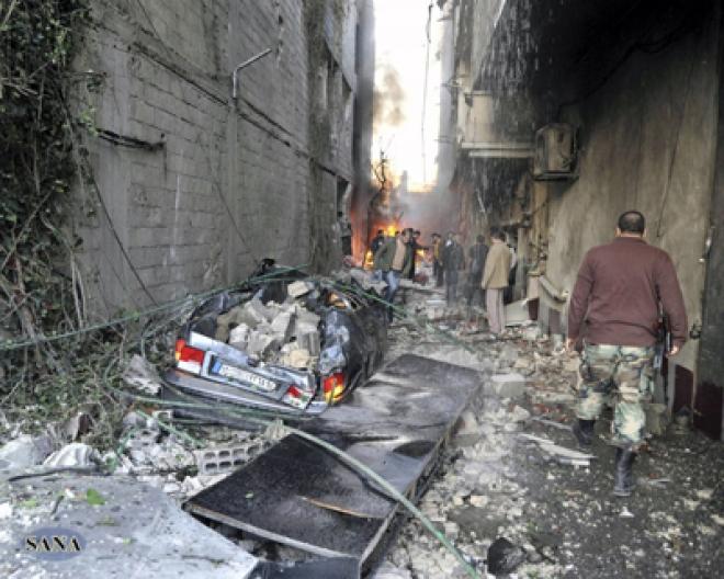 Twin car bomb kills at least twenty people in Damascus