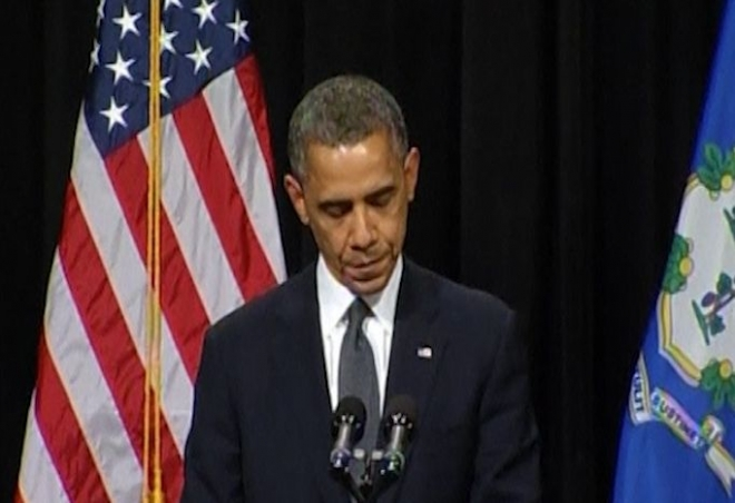 Obama shares grief with families of shooting victims