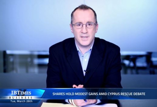 Shares hold modest gains amid Cyprus rescue debate