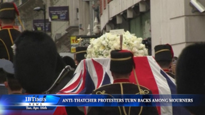Anti-Thatcher Protesters Turn Their Backs Among Thatcher Mourners