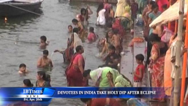 Devotees In India Take Holy Dip In Ganges