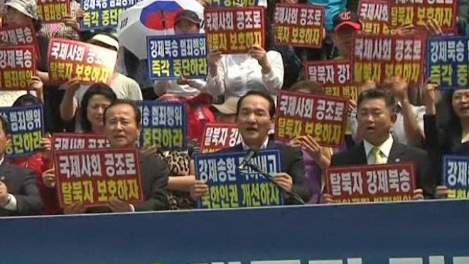 South Koreans Protest Against Forced Repatriation