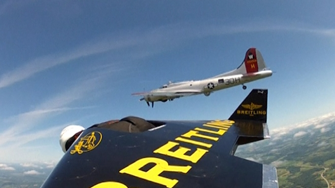 Swiss Jetman Flies Alongside B-17 Aircraft